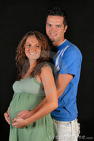 Portrait of happy and pregnant couple.
