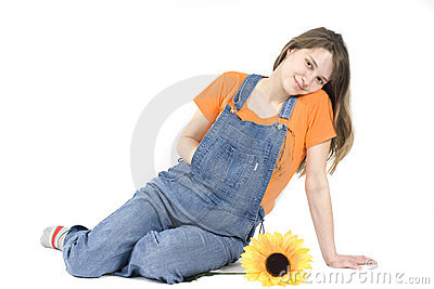 Portrait of a happy pregnant woman with sunflower