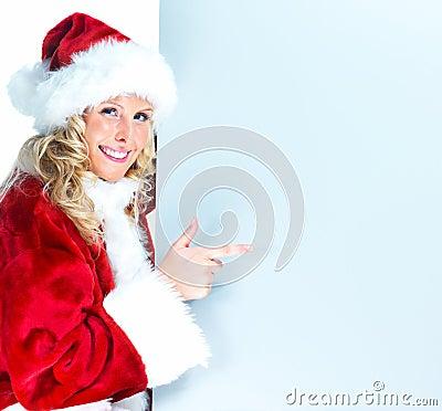 Portrait of happy santa pointing at copyspace