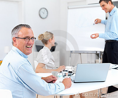 Portrait of a happy senior man at a meeting