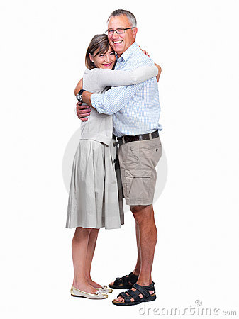 Portrait of happy senior man and woman embracing