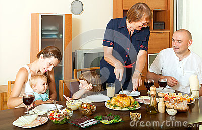 Portrait of happy smiling family communicate over holiday table