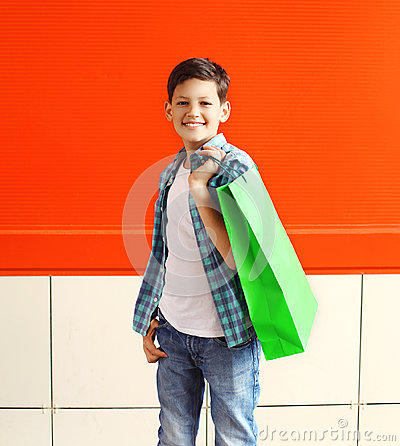 Free Portrait Happy Smiling Little Boy Teenager With Shopping Bag In City Stock Photo - 61636130