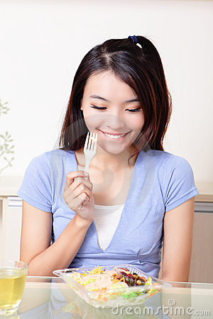 Portrait of happy smiling young woman eat salad