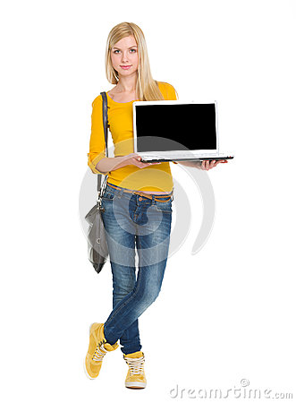 Portrait of happy student girl showing laptop