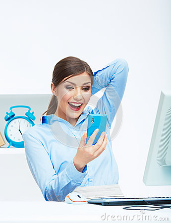 Portrait of happy surprised business woman on phon