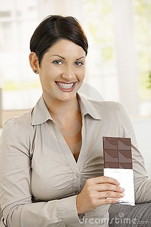Portrait of happy woman holding chocolate