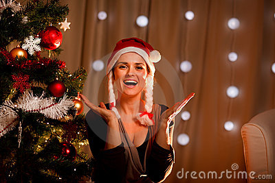 Portrait of happy woman near Christmas tree