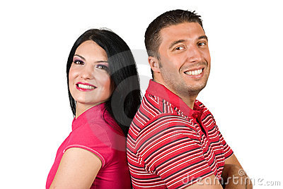 Portrait of happy young couple in pink
