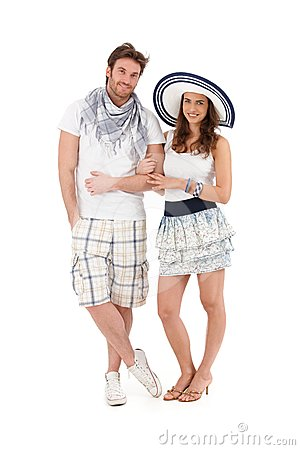 Portrait of happy young couple in summer outfit