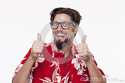 Portrait of a happy young man gesturing thumbs up against white