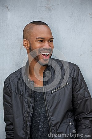 Portrait of a happy young man laughing