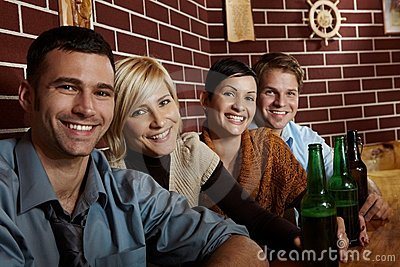 Portrait of happy young people in pub