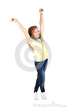 Portrait of a happy young woman enjoying music