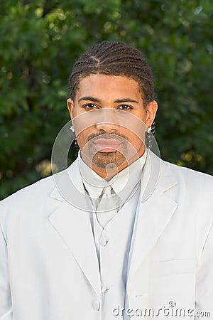 Portrait headshot of ethnic black man in white