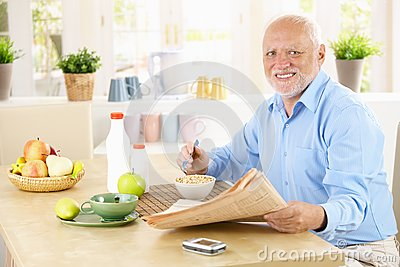 Portrait of healthy senior at breakfast
