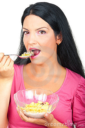 Portrait of healthy woman eating cereals
