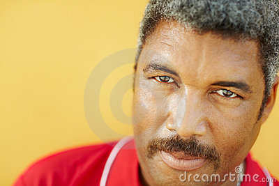 Portrait of hispanic mature man staring at camera