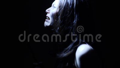 Portrait of a horror Halloween Scream inspired teen girl with a knife stock footage