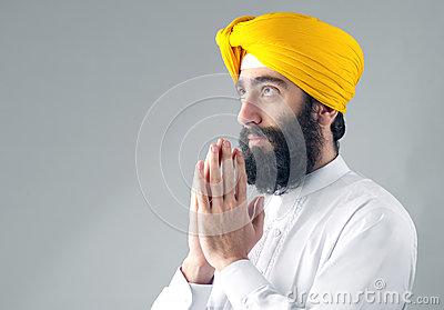 Portrait of Indian sikh man with a bushy beard praying