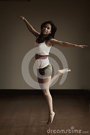 Portrait of an Indonesian girl jumping
