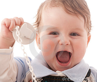 Portrait of joyful baby boy with pacifier