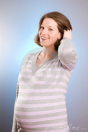 Portrait of joyful beautiful pregnant woman
