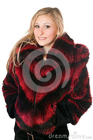 Portrait of joyful blond woman in fur jacket