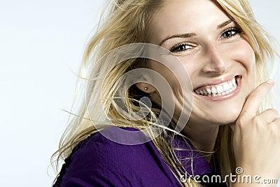 Portrait of a joyful blond woman smiling