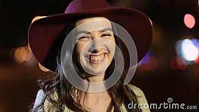 Portrait of joyful girl laughing in night street stock video