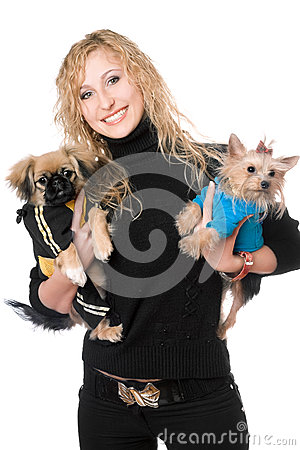Portrait of joyful pretty blonde with two dogs