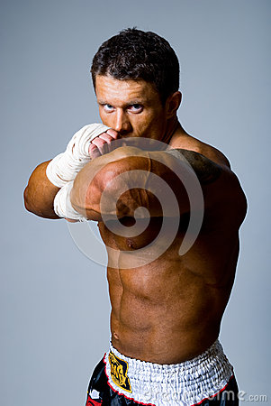 Portrait of a kick boxer in fighting stance