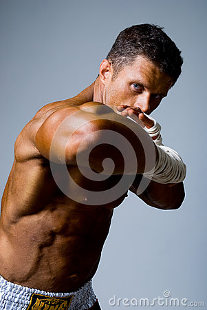 Portrait of a kick boxer in fighting stance.