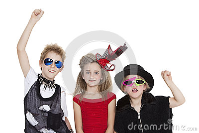 Portrait of kids fancy dress outfit with raised fist over white background