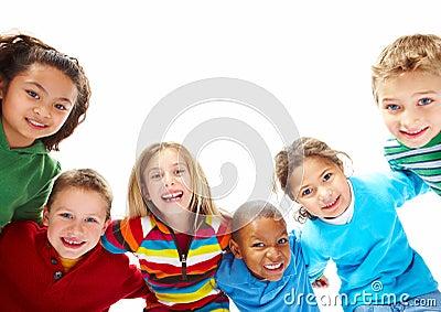 Portrait of kids in playful mood bending down