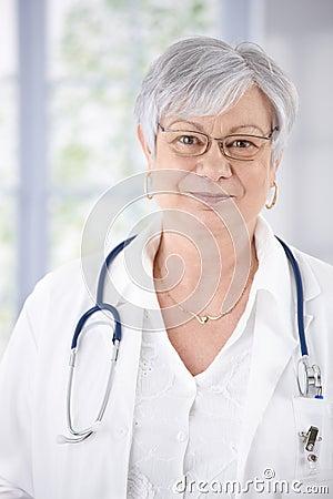 Portrait of kindly smiling female senior doctor