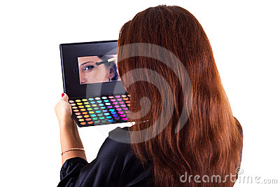 Portrait of lady with eyeshadow and brush