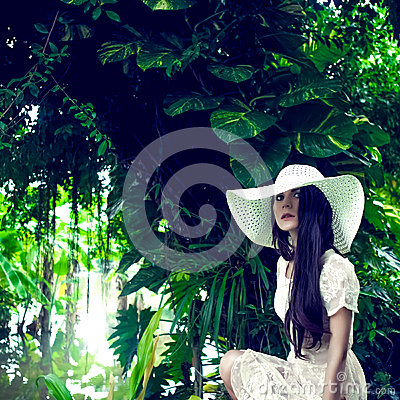 portrait of a lady in a tropical forest