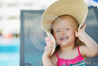 Portrait of laughing baby in hat