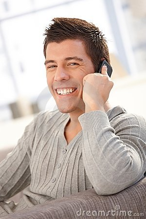 Portrait of laughing guy speaking on cellphone