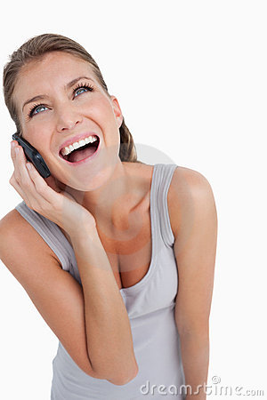Portrait of a laughing woman making a phone call
