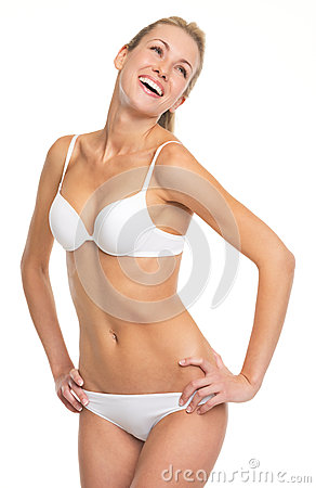 Portrait of laughing young woman in lingerie Stock Photo