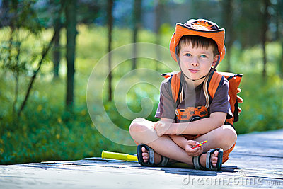 Portrait of a little boy in summer forest