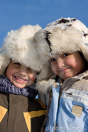 Portrait of little girl and boy in the fur-cap