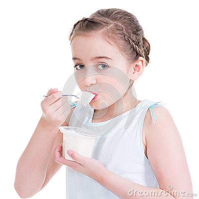 Portrait of a  little girl eating yogurt.