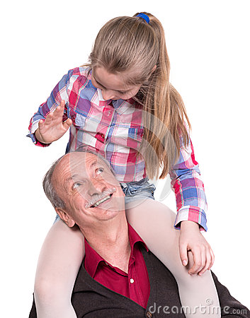 Portrait of a little girl enjoying piggyback ride with her grand