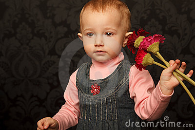 Portrait of little girl with flowers in her hands
