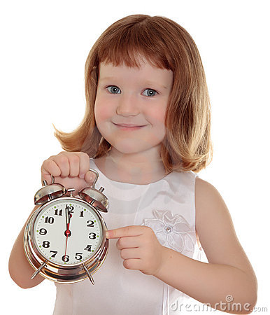 Portrait of little girl holding alarm clock