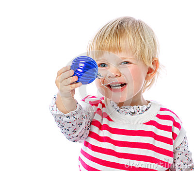 Portrait of a little girl holding a Christmas ball, celebration,