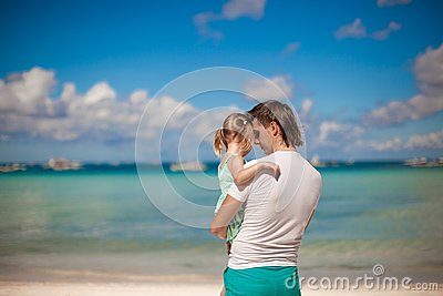 Portrait of a little girl hugging with dad on the